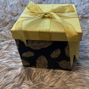 Pretty feathered box. Black and gold